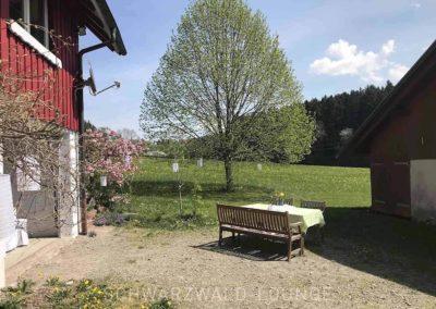 Ferienhaus Brestenberg: Garten und Hof mit Sitzgelegenheiten