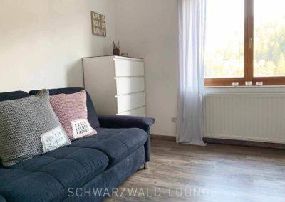 Wellness-Apartment Waldwiese: Die gemütliche Schlafcouch im Schlafzimmer