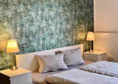 Ferienhaus Brestenberg: Schlafzimmer 1 im Erdgeschoss mit Doppelbett