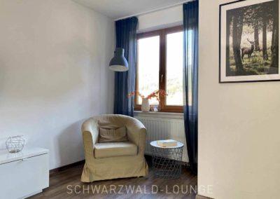 Luxus-Ferienwohnung Bergsee: Die Leseecke im Wohnzimmer